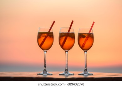 Refreshing aperitif Aperol spritz against the sunset.