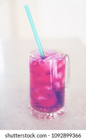 Refreshing beverage in a glass mug with los of ice