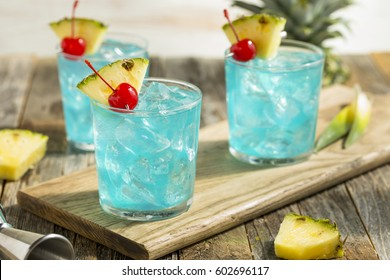 Refreshing Blue Hawaii Cocktail Punch with Pineapple and Cherry