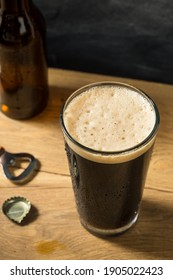 Refreshing Boozy Dark Stout Beer in a Pint Glass