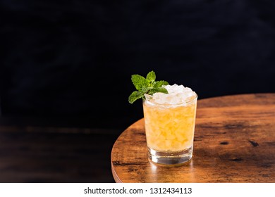 Refreshing Bourbon Mint Julep Cocktail on a Table