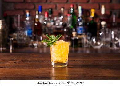 Refreshing Bourbon Mint Julep Cocktail on a Bar