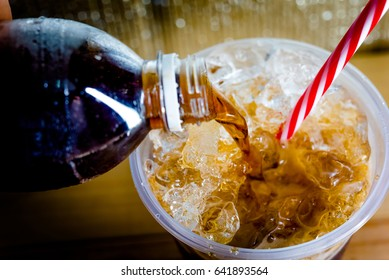 Refreshing Bubbly Soda Pop with Ice Cubes. Cold soda iced drink in a glasses - Selective focus, shallow DOF.