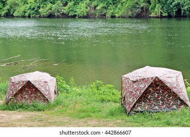 Refreshing by camping in tent nearby river and green environment