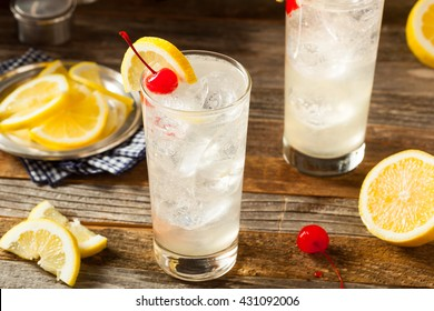 Refreshing Classic Tom Collins Cocktail with a Cherry and Lemon Slice