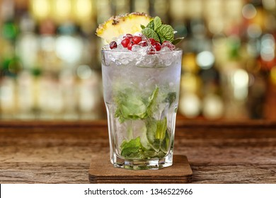 Refreshing cocktail with ice. Georgian Julep. Drinks with brandy, mint and cranberry.