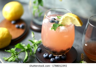 A refreshing cocktail. This drink is made with fresh blueberries, blueberry vodka and lemonade.  A lemon wedge, fresh mint and ice make this a great summertime refresher.
