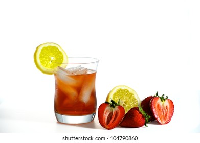 Refreshing cold glass of Iced Tea with Lemon and Strawberries.
