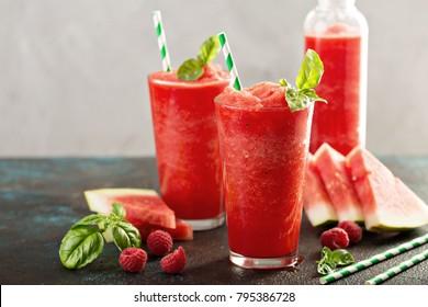 Refreshing cold summer drink watermelon slushie with basil