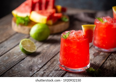 Refreshing cold summer watermelon drink in glasses with slices of watermelon and lime