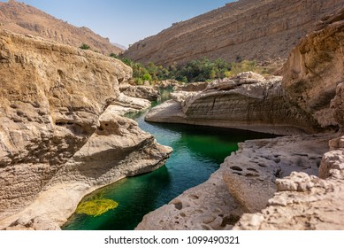 the refreshing cold water of the oasis of Wadi Bani Khalid in Oman