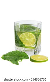 Refreshing drink with lime and mint on a white background
