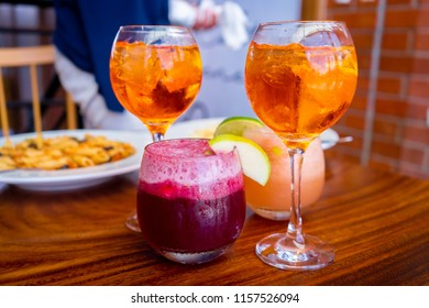 Refreshing drinks in a glass in an Italian restaurant.