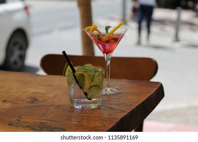 Refreshing drinks on the edge of a wooden table.