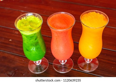 Refreshing Frozen in diferent flavors in a glass.