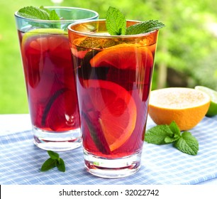Refreshing fruit punch in two glasses outside