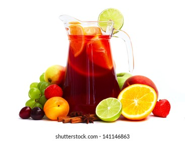 Refreshing fruit sangria in jug with different fruits isolated on white