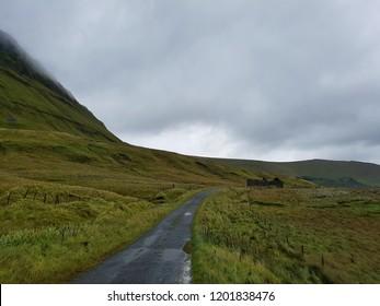Refreshing green hilly landscape around rural road, Gleniff horseshoe drive near Dartry mountain range, Sligo, Ireland.