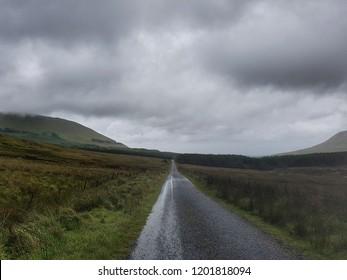 Refreshing green hilly landscape of rural road of Gleniff horseshoe drive in Sligo, Ireland.