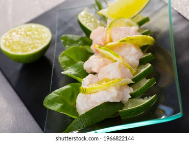 Refreshing hake ceviche with lime. Recipe - 200g hake fillet, 1 onion, 1 jalapeno, 1 garlic clove, juice of 1 lime, salt. Chop all ingredients, season with lime juice and salt