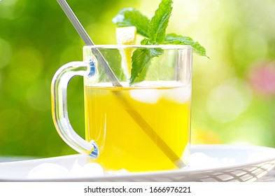 Refreshing ice tea in a glass outdoors