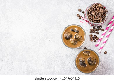 Refreshing iced coffee on concrete background. Top view, space for text.