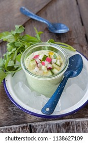 Refreshing iced cucumber soup with fresh radish and olive oil