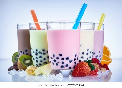 Refreshing iced milky bubble tea with tapioca pearls made with fresh fruit ingredients including raspberry, strawberry, kiwi, orange, apple and banana