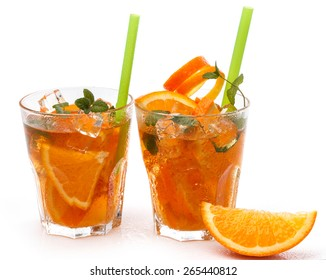 Refreshing lemonade with oranges and mint on white background