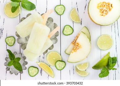Refreshing mexican style ice pops - cucumber, lime, honeydew margarita paletas - popsicles. Top view,  overhead. Cinco de Mayo recipe