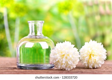 refreshing natural beauty culture, a bottle of herbal essences and two white flowers, Spa and health care concept - Shutterstock ID 128333720