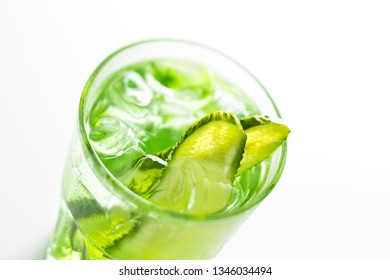 Refreshing non-alcoholic summer cocktail with cucumber close up soft focus on a white background