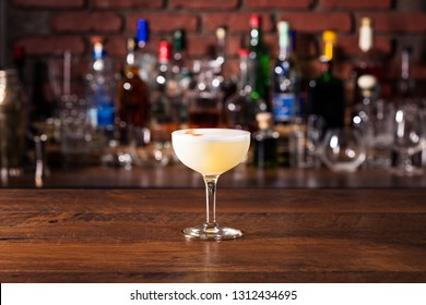 Refreshing Pisco Sour Cocktail on a Bar