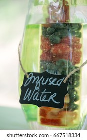 A refreshing pitcher of fruit infused water at an outdoor party.