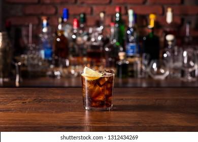 Refreshing Rum and Cola Cocktail on a Bar