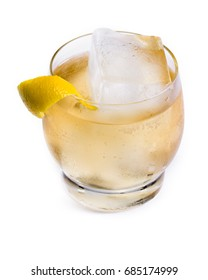 refreshing scotch and soda served on the rocks with a lemon twist isolated on a white background