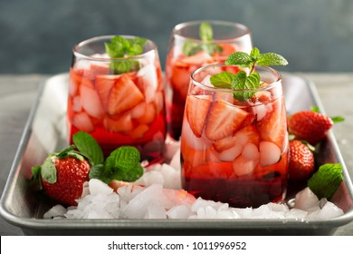 Refreshing strawberry ice tea or cold cocktail