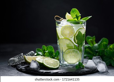 Refreshing summer alcoholic cocktail mojito with ice, fresh mint and lime