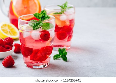 Refreshing summer cocktail. Cold drink Raspberry Lemonade with mint in glass.