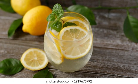 refreshing summer cocktail with lemon slice on the table