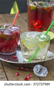 Refreshing summer cocktails - elderflower with prosecco and pomegranate with ginger ale and ice