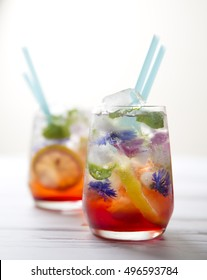 Refreshing summer drink with lemon and flower