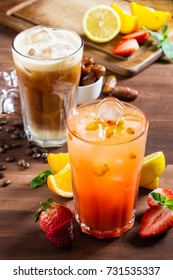 Refreshing summer drinks. composition on the table. Frappe and sea buckthorn lemonade with strawberries