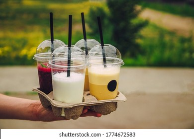 Refreshing summer drinks take-away from a coffee shop. Milkshake, coffee and smoothie. High quality photo