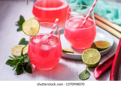 Refreshing summer rhubarb lemonade drink with lime and mint
