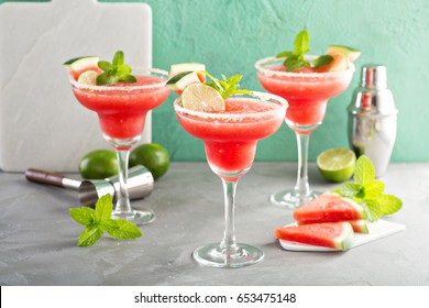 Refreshing summer watermelon margaritas with lime and mint