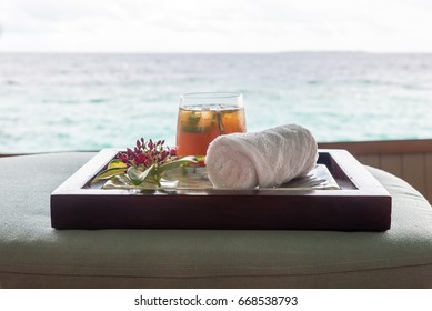 refreshing towel and ice tea at a spa