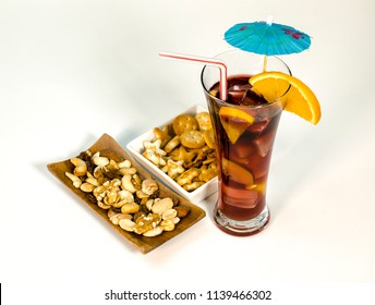 Refreshing typical sangria drink from Spain, with ice and fruits. With nuts