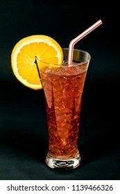 Refreshing typical sangria drink from Spain, with ice Orange slice on black background