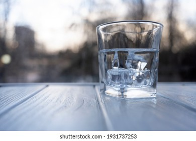 Refreshing water with ice on the table